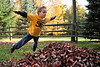 10-26-2009 - &quot;Liftoff&quot;  Part of the joy of living in NE Ohio is the raking of leaves and the subsequent jumping into the piles.  &quot;It's a family tradition&quot; to quote Hank.  They look forward to it as soon as they see leaves on the ground.  Yesterday was a perfect opportunity for them to hone their leaf-pile-jumping skills.