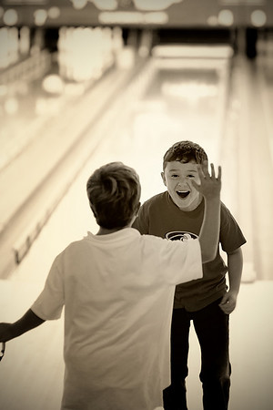 "9/20/10 - ""Strike""  Kids' birthday parties are always so fun.  This kid was so animated about each of his shots...he finally managed a strike, and it was so fun to watch.  That's my Nick waiting to give him a high five...what fun.  Unfortunately for you, I have a few bowling alley shots that will make their way into my dailies this week.  Hope you enjoy them!  Have a great week!"