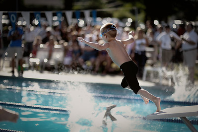 "July 24, 2011 - ""First Flight"".  This is his first jump off the platform.  He has always started races from the side of the pool, but was coaxed into jumping off the platform for this meet.  I think M&Ms were involved :).  I was fortunate to be in the right place at the right time."