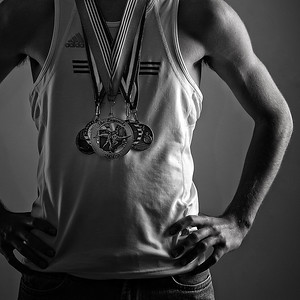 Here is an image of a senior shoot I had the other week.  This young man was quite the accomplished Track athlete, and we took some images of him and a small sampling of his medals.